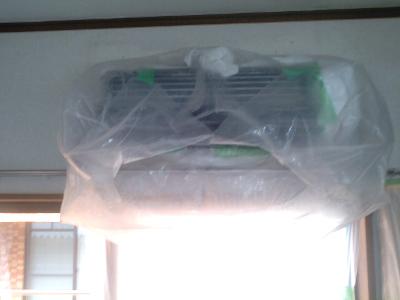 水が飛ばないようにカバーをかけ洗浄します